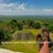 man's shoes overlooking xunantunich maya site ruins in belize caribbean