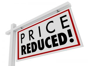 Price Reduced words on a home for sale sign